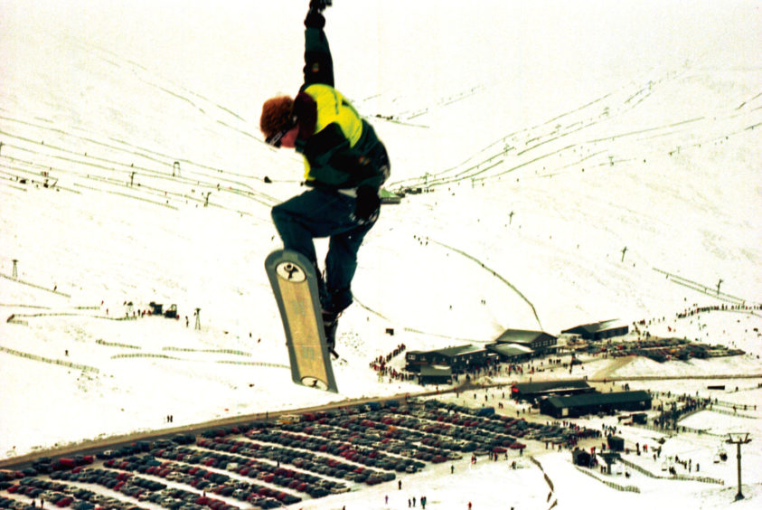 1996: A boarder shows some top moves during the Air and Style competition
