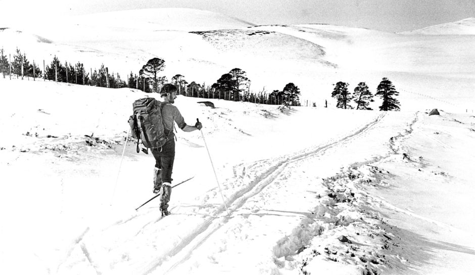 1986: A cross country skier on Glen Quoich with Meall an Lundain in the distance