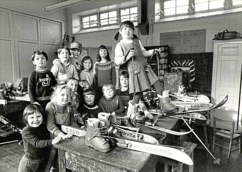 1984: The keen skiers of Primary 1, 2 and 3 preparing their skis for a forthcoming competition at Glenshee