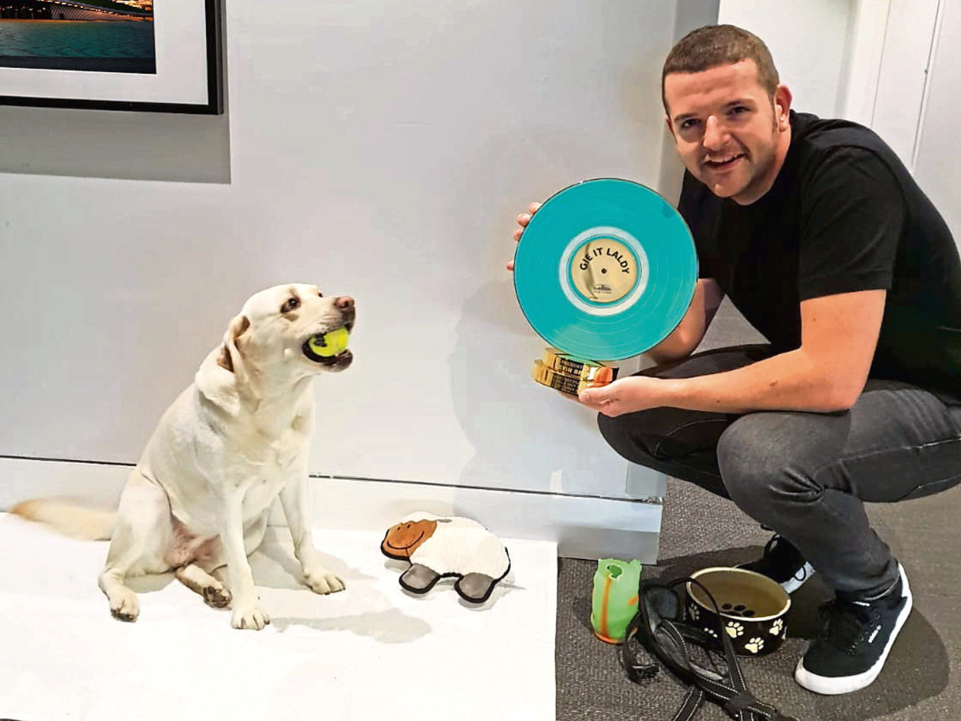 Kevin Bridges with his golden Labrador Annie who he takes on tour with him