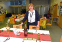 Lieutenant Helen Froud of the Salvation Army gets ready to serve Christmas meals