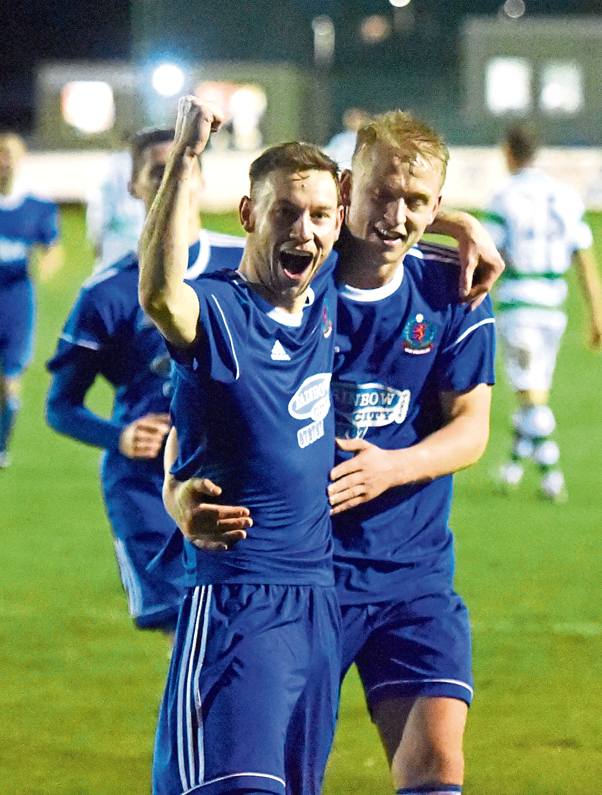 Mitch Megginson with Cove team mate Harry Milne after scoring a hat-trick against Buckie Thistle. Picture by JASON HEDGES