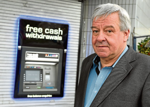 Brian Ogg at the new cash machine