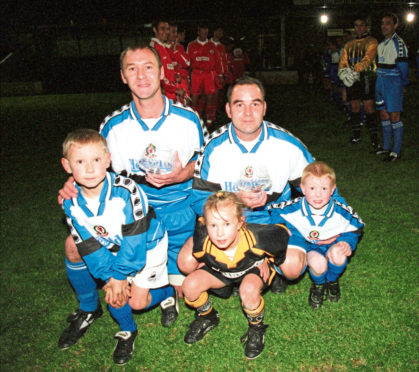 Cove Rangers players Mike Megginson (left) with his children Mitchell and Mikela and Dave Whyte with his nephew Darren Whyte (far right) before their testimonial match against Aberdeen at Allan Park.