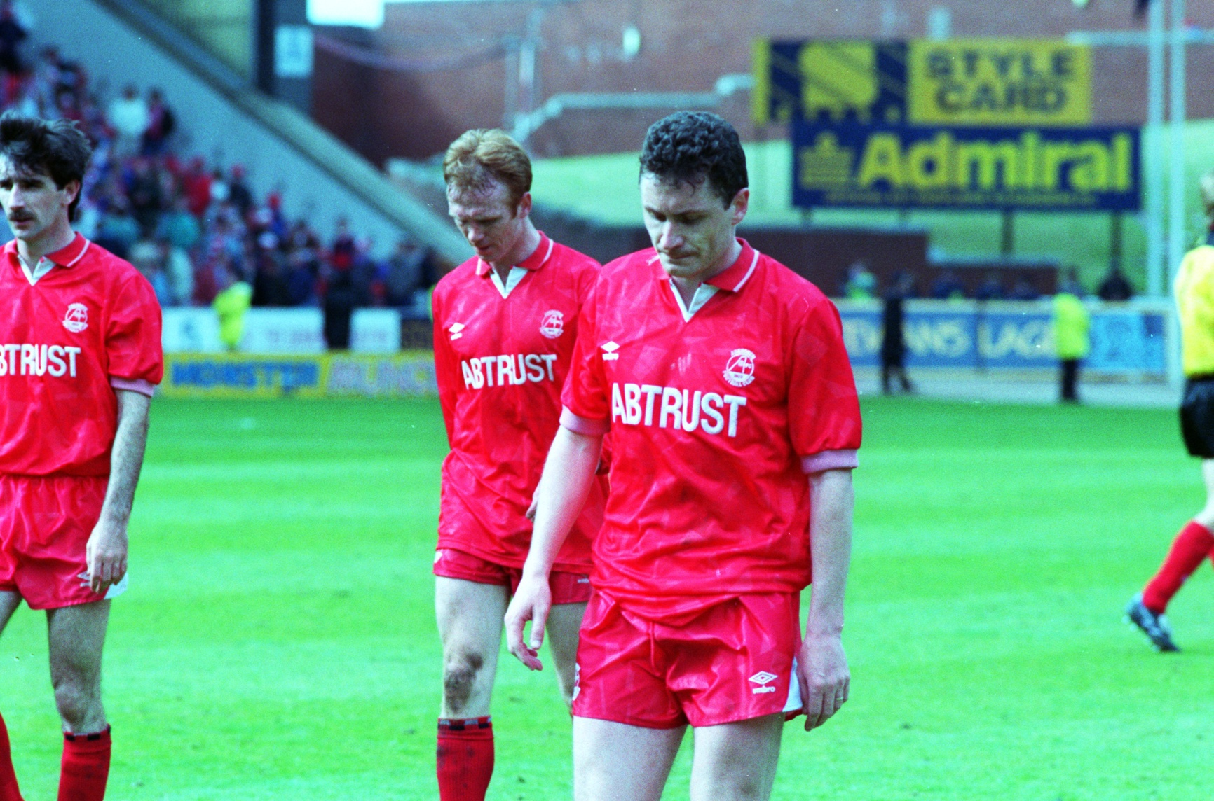 Jim Bett trudges off the Ibrox pitch after Aberdeen missed out on the title.