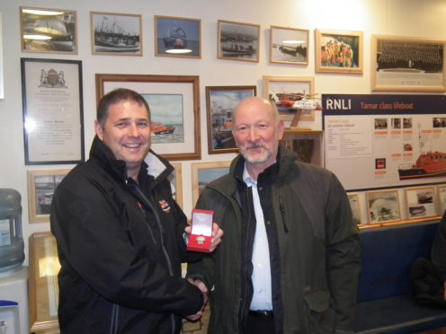 Andy with his 30-year long service medal
