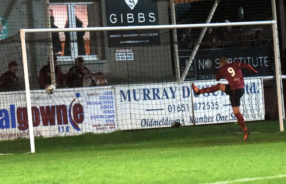Chris Angus smashes into an empty net.