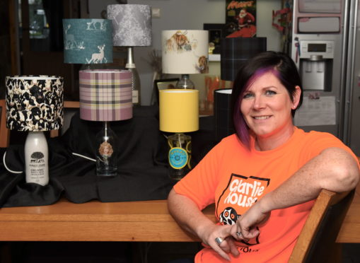 Lynne Anderson with some of her bespoke gin bottle lamps