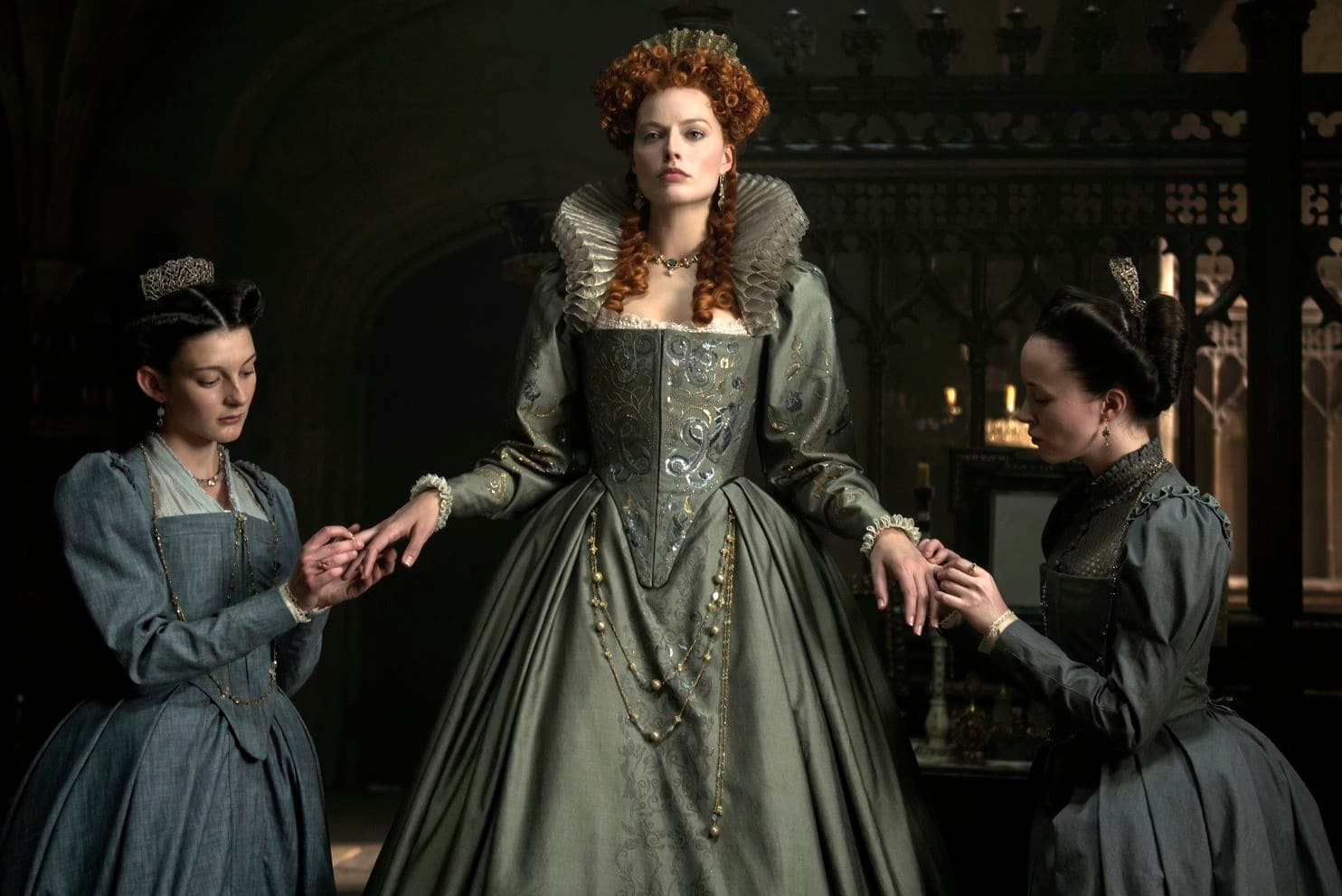 Grace Molony as Dorothy Stafford, Margot Robbie as Queen Elizabeth I and Georgia Burnell as Kate Carey in a scene from Mary Queen of Scots.