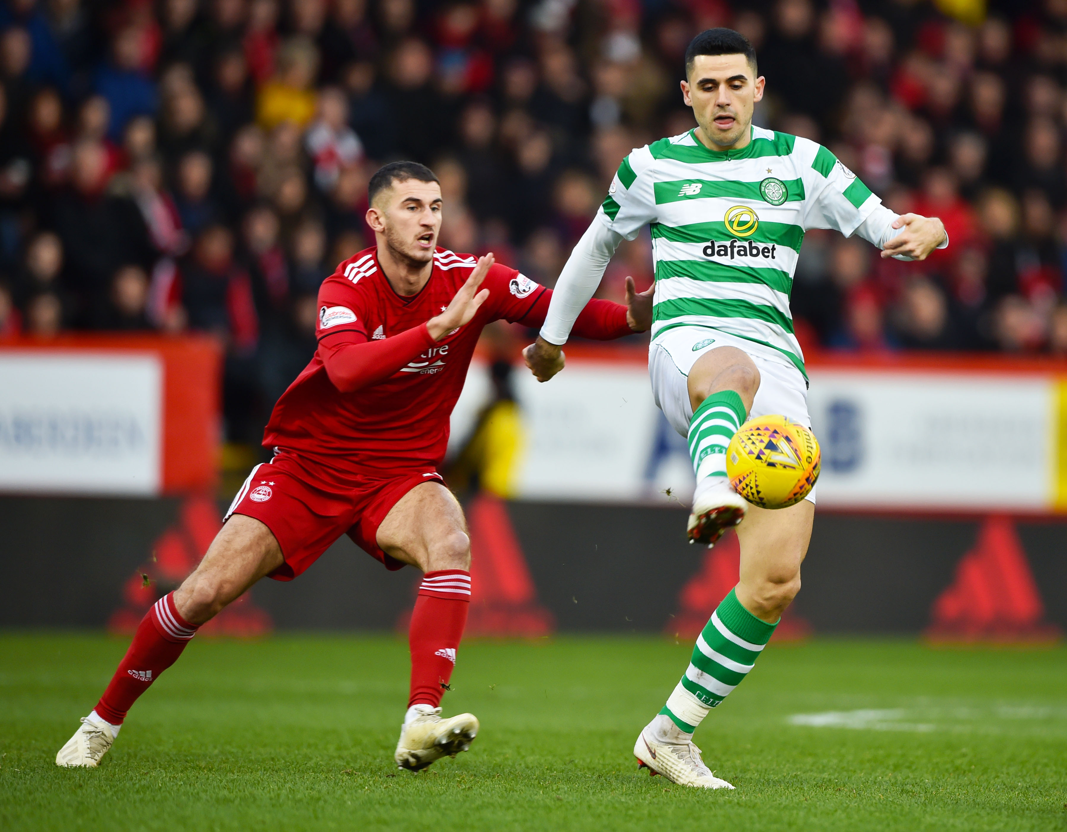Celtic's Tom Rogic, right, in action with Aberdeen's Dominic Ball.