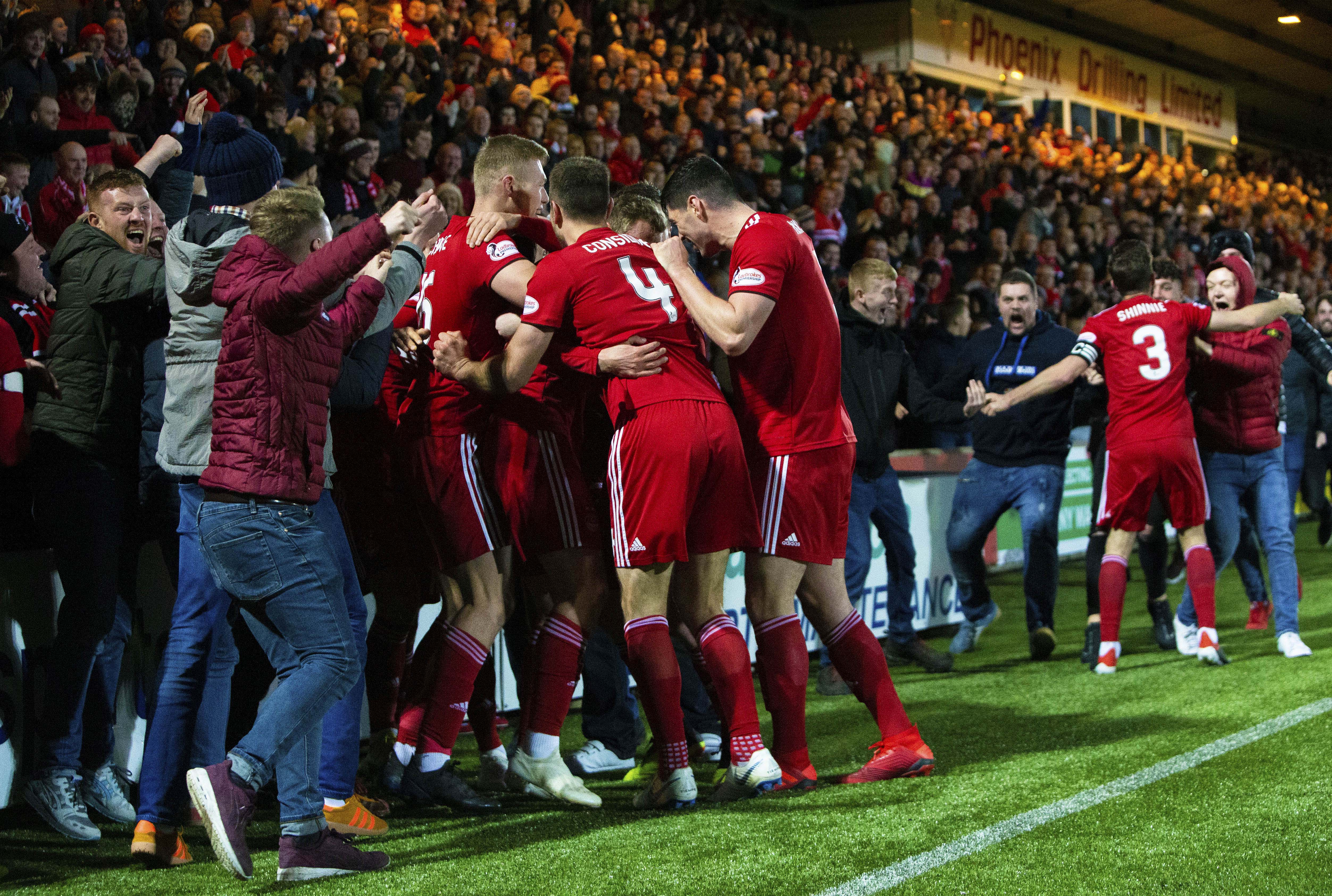 Aberdeen celebrate with their support after James Wilson fires them in front on the artificial pitch at  Livingston in December.