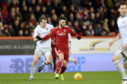 Hearts' Christophe Berra and Aberdeen's Connor McLennan. Picture by Darrell Benns