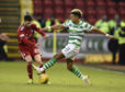 Celtic's Scott Sinclair (right) and Aberdeen's Connor McLennan battle for the ball during the Scottish Premiership match at Pittodrie.