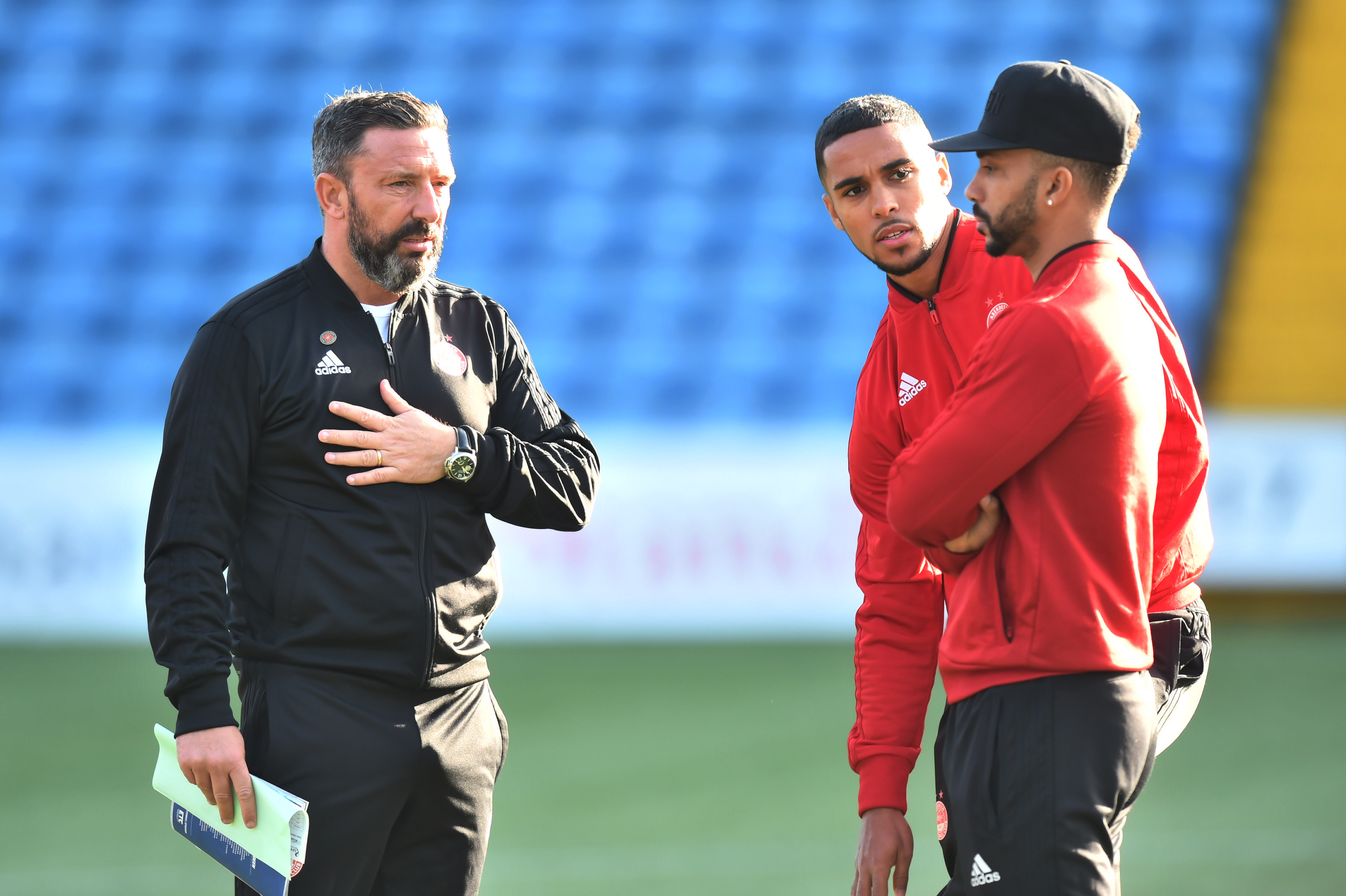 Aberdeen manager Derek McInnes with Max Lowe and Shay Logan.
