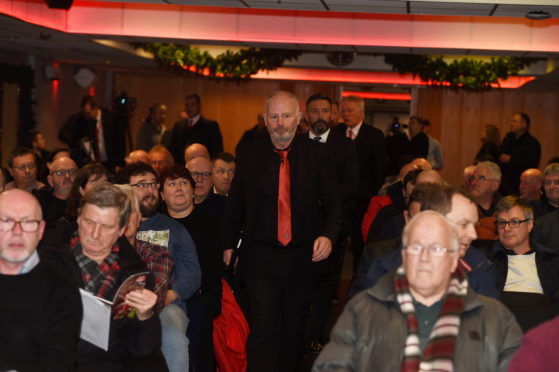 Stewart Milne arrives at Aberdeen's 115th AGM.