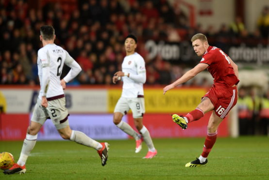 Aberdeen's Sam Cosgrove has a shot against Hearts at Pittodrie.  Picture by Darrell Benns.