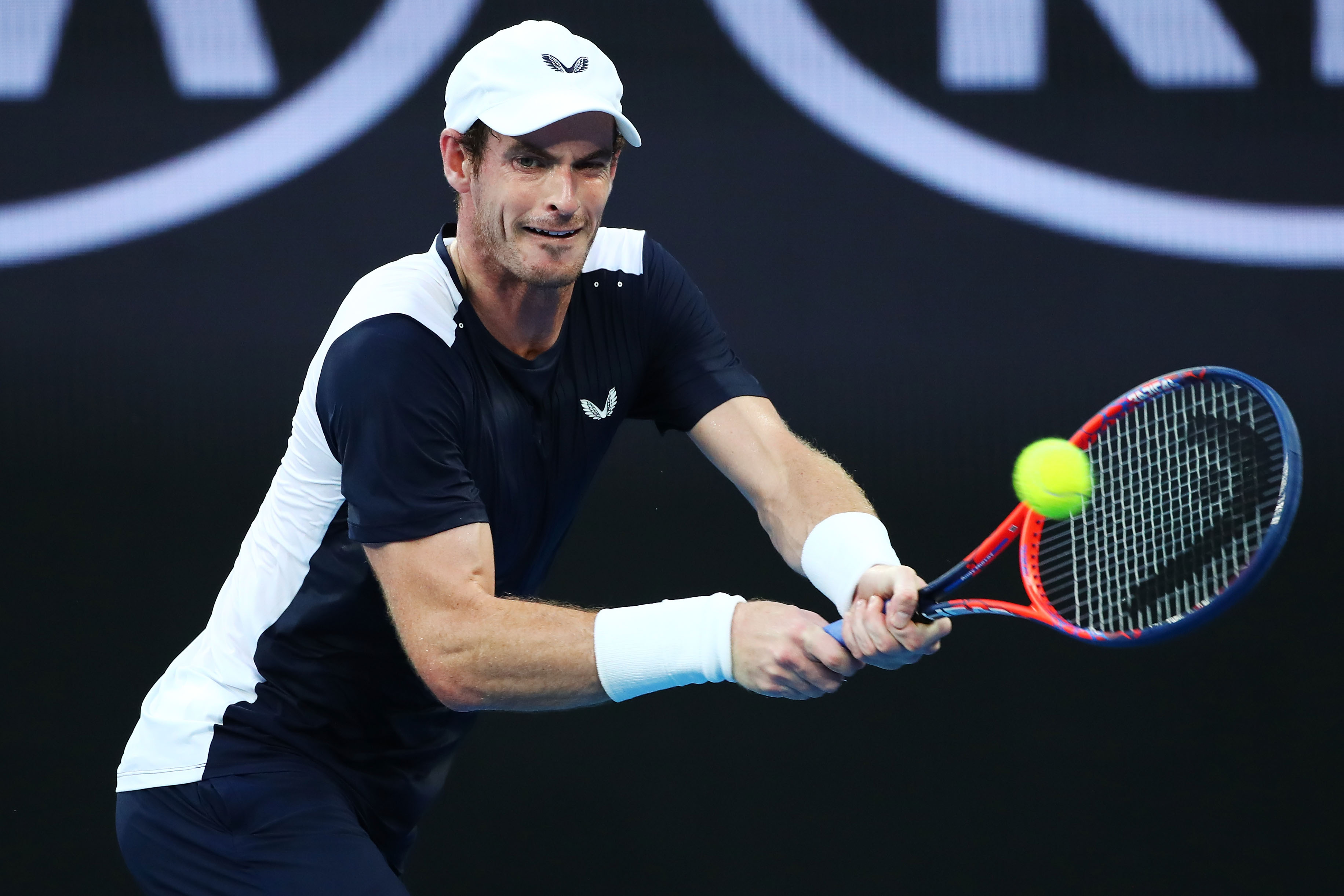 Andy Murray of Great Britain plays a backhand in his first round match against Roberto Bautista Agut of Spain during day one of the 2019 Australian Open at Melbourne Park on January 14, 2019 in Melbourne, Australia.