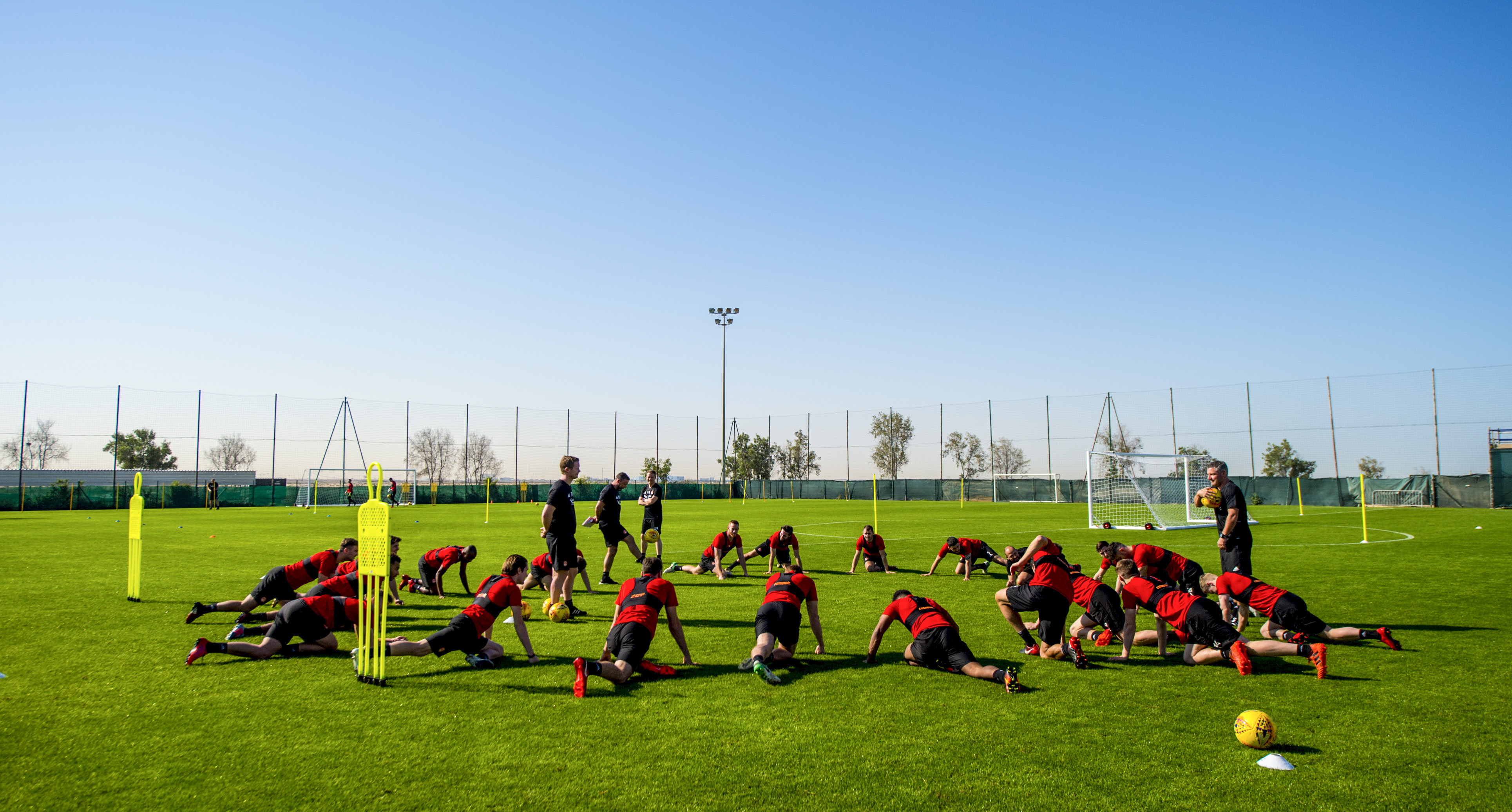 The Aberdeen players stretch during training in Dubai last year.