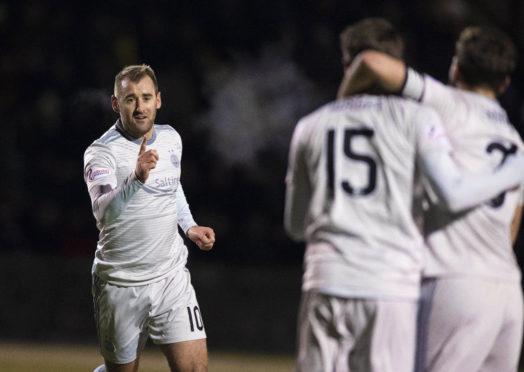 Niall McGinn, left, celebrates after firing Aberdeen ahead.