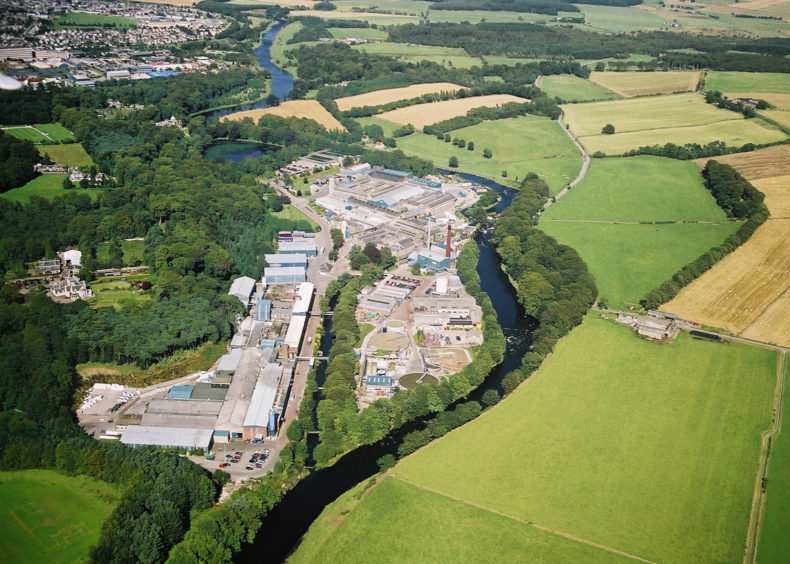 Looking across Stoneywood Paper Mill towards Dyce in the top left