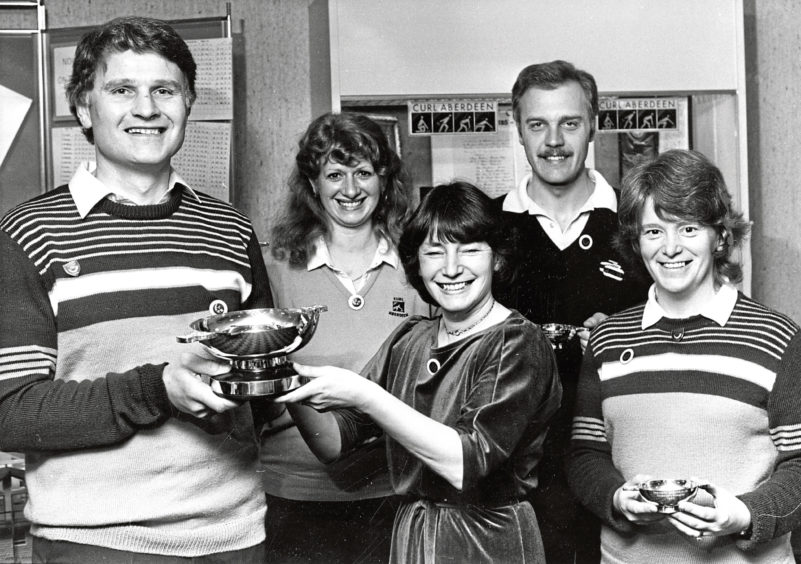 1985: George Rogerson, skip of the winning team in the Banchory Curling Club centenary bonspiel at Stoneywood, receives the trophy from Christine Paterson, the club's women's president. Team members were, from left,  Beverley Forrest, George Cooper and Marguerite Chapman