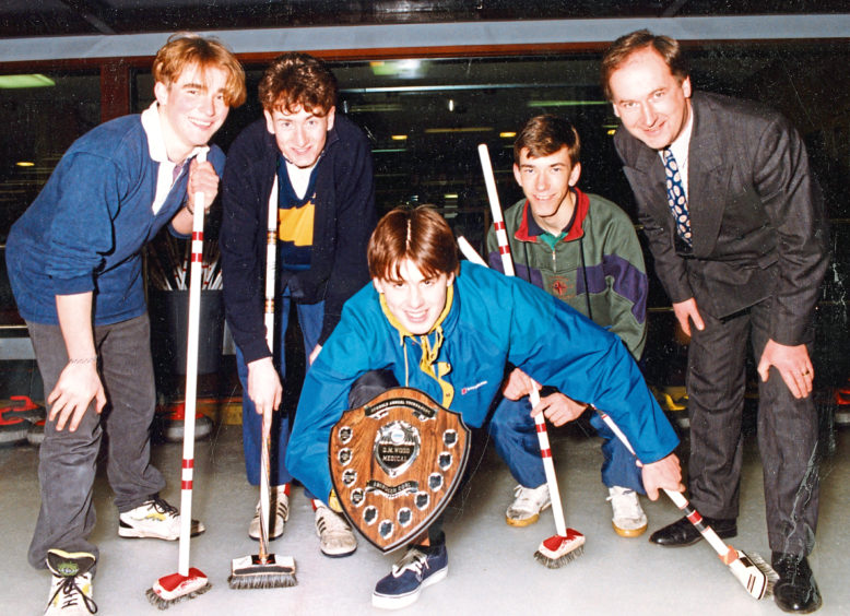 1991: Scott Johnson, 16, prepares to deliver the shield to the Robert Gordon's College team which won the schools  curling tournament at Stoneywood. With him, from left, are Paul Preacher, 18, David Maxwell, 18, Graeme Chandler, 17, and Mr Wood.