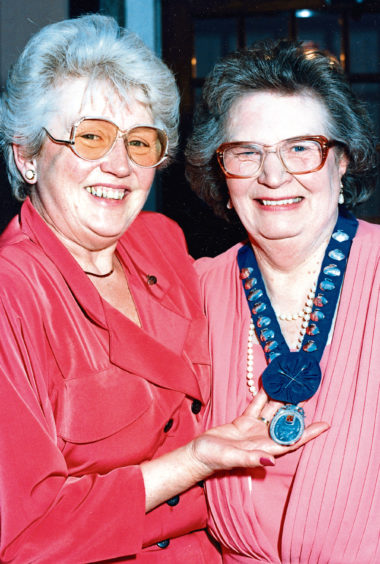 1991 : Elma Martin, past president of the Aberdeen Ladies Curling Club, left, hands over to the new president, Annabel Hogg at their annual dinner and prizegiving at the Palm Court