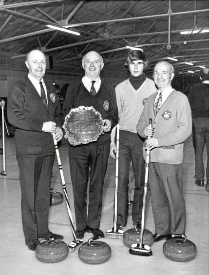 1975: Skip Jack Suttie proudly displays the Westburn Salver which his team, Aberdeen, won in the Scottish Grocers' Federation curling championship at Falkirk. Other members of the team are, from left, Hugh Thom, David Suttie and Duncan McGregor