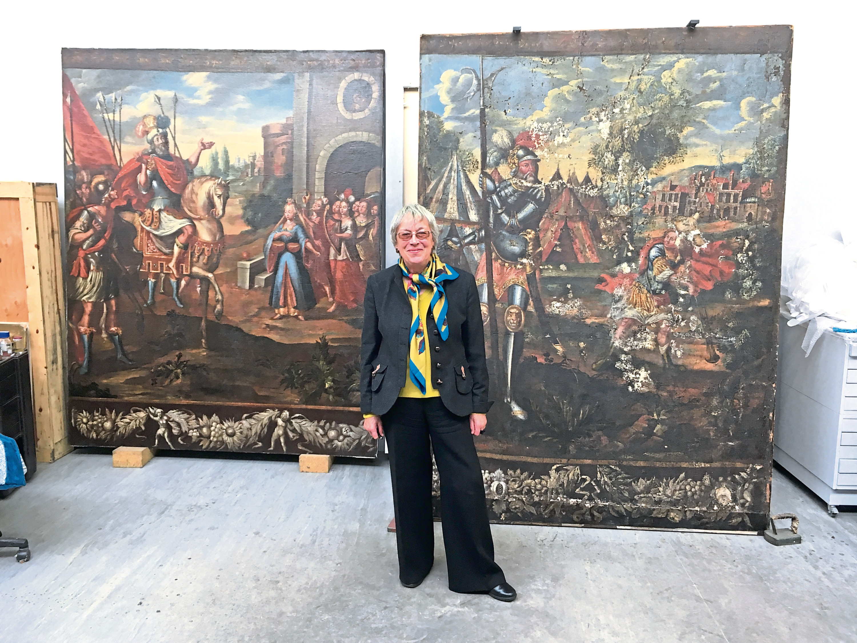 Anne Harper with the restored canvas Jephtha and his Daughter to the left, and below, the paintings are being restored in Glasgow