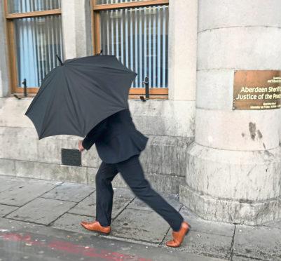 Michael Hetherington leaves Aberdeen Sheriff Court