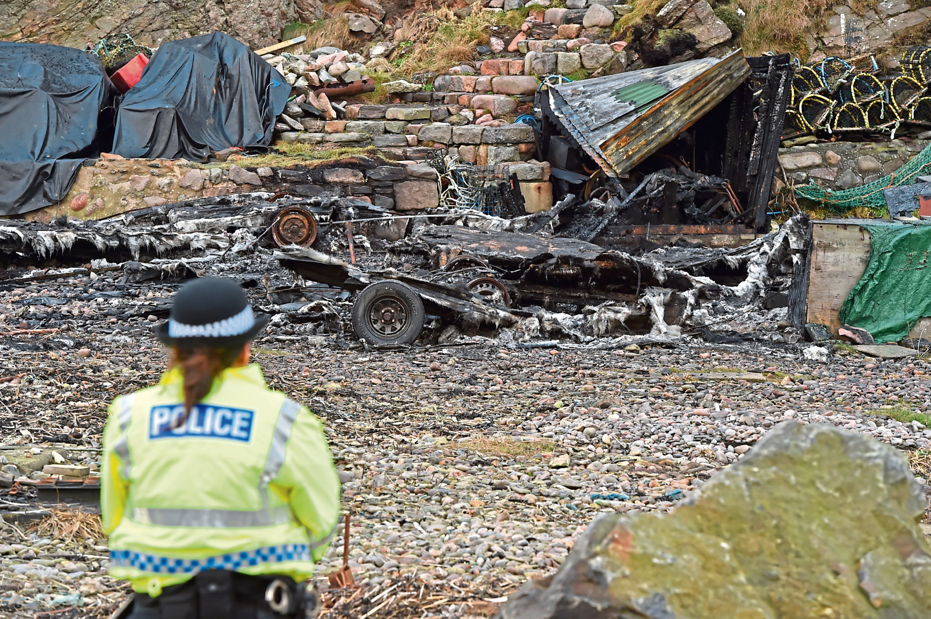 Police at the scene of the fire at Cove Harbour