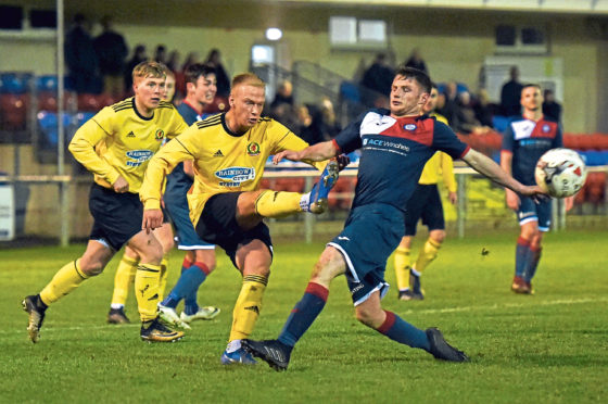 Cove's Jordon Brown and Turriff's Michael Ironside. Picture by Heather Fowlie
