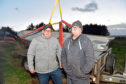 George Skinner, left,  lost his boat in a fire at Cove Harbour and has been given a new one by boat builder James Anderson, right