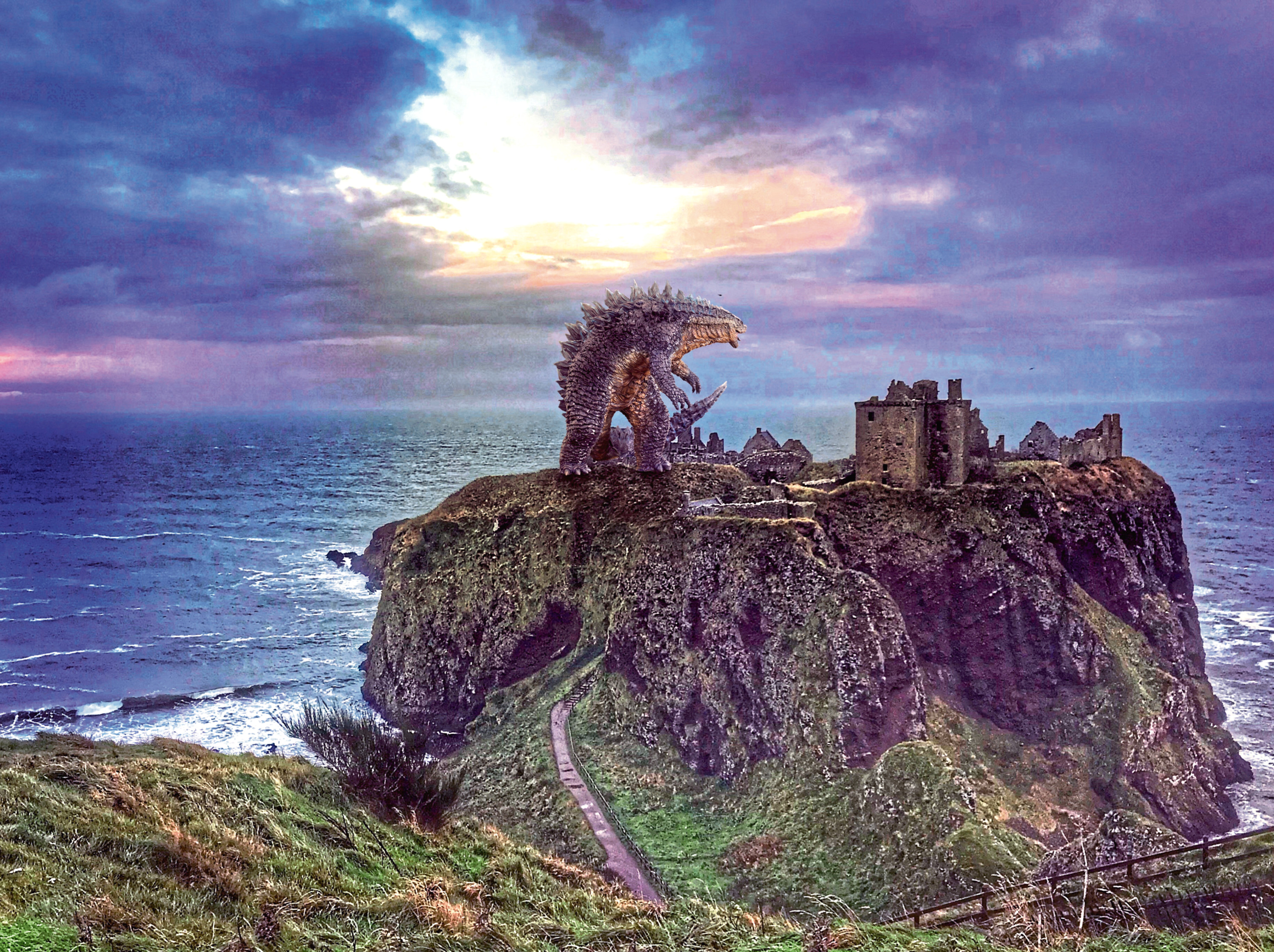 The King of Monsters enjoying the breathtaking scenery of Dunnottar castle during his 'visit' to the north-east