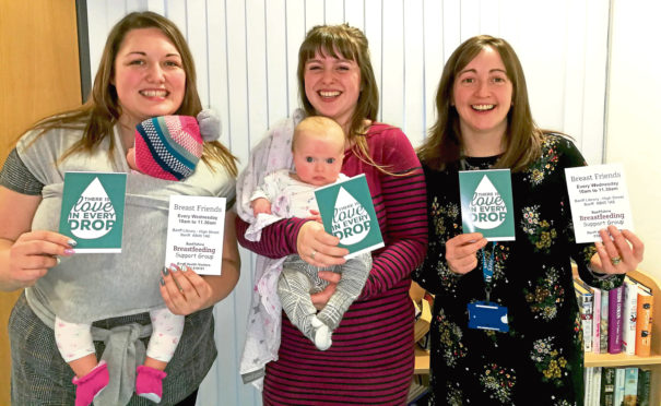 Lindsay Michie, community Nursery Nurse, with Phoebe Johnson, her baby girl India and Health Visitor Louise Whyte