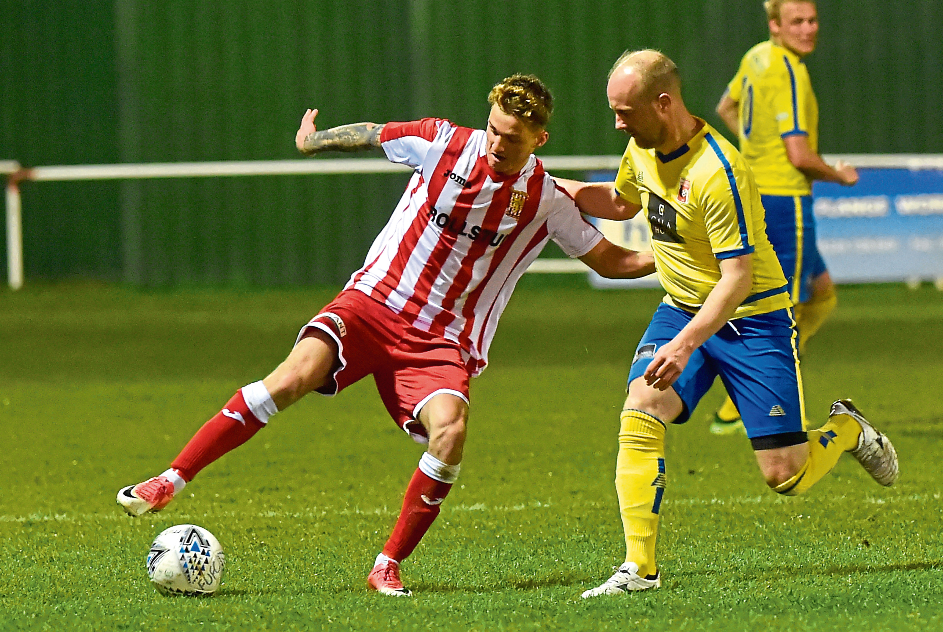 Formartine's Aaron Norris, left Picture by KENNY ELRICK