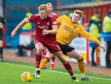 Aberdeen's Sam Cosgrove battles with Stenhousemuir's Conner Duthie.