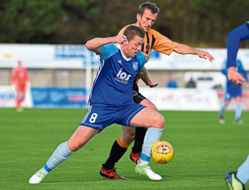Scottish League Two - Peterhead (blue) v Berwick Rangers (orange) at Balmoor Stadium, Peterhead. Picture of (L-R) Scott Brown and John Neill.  Picture by KENNY ELRICK     22/09/2018