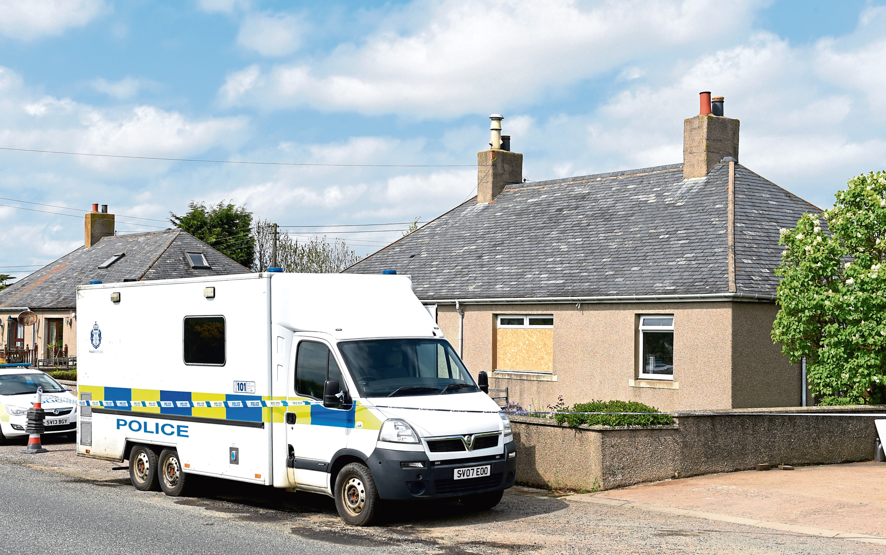 Police at the scene where Mr McKandie was found