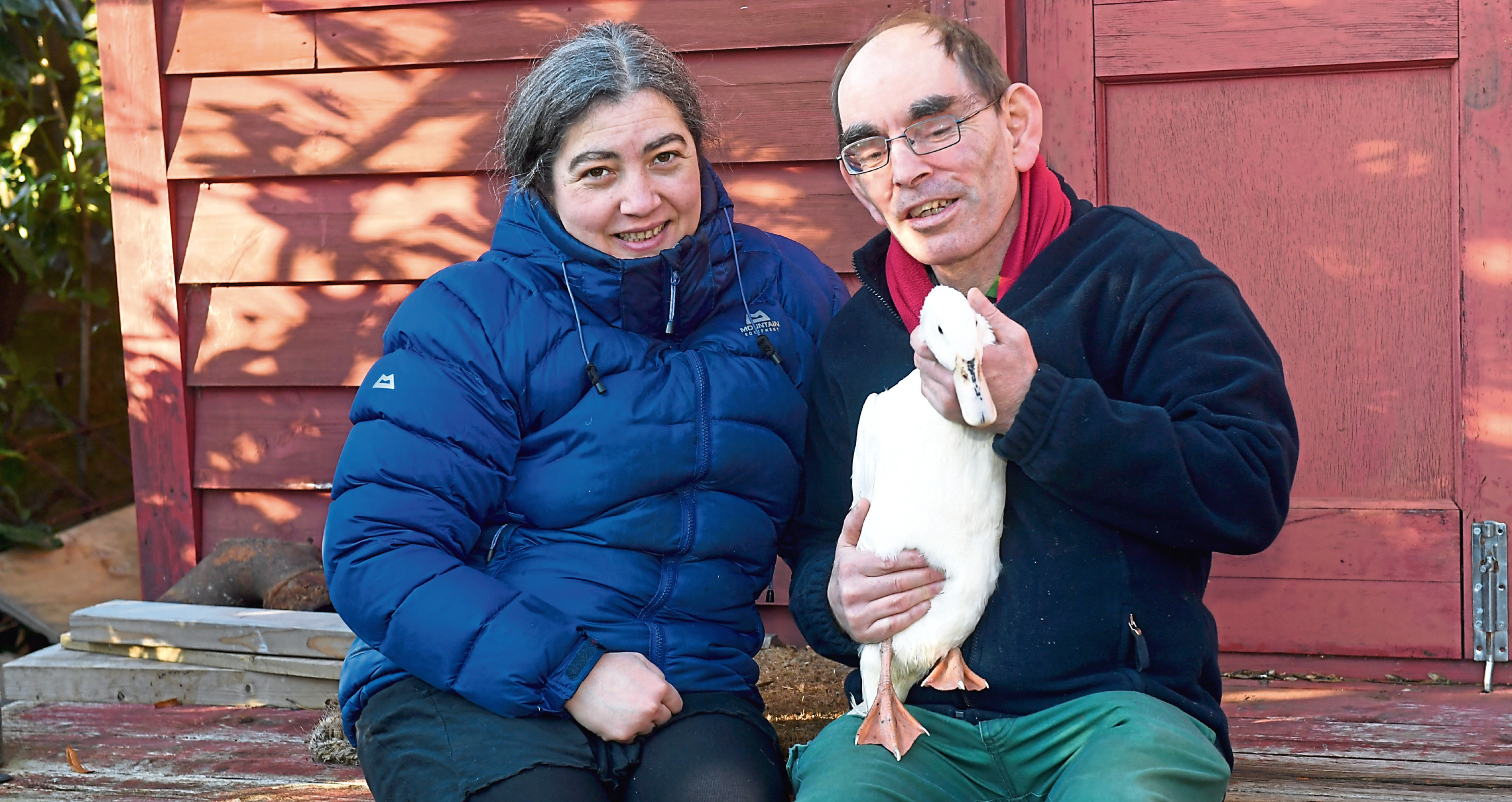 Margaret Swerling, one of the care home managers, with resident David Craib and Chirpy. Picture by Chris Sumner