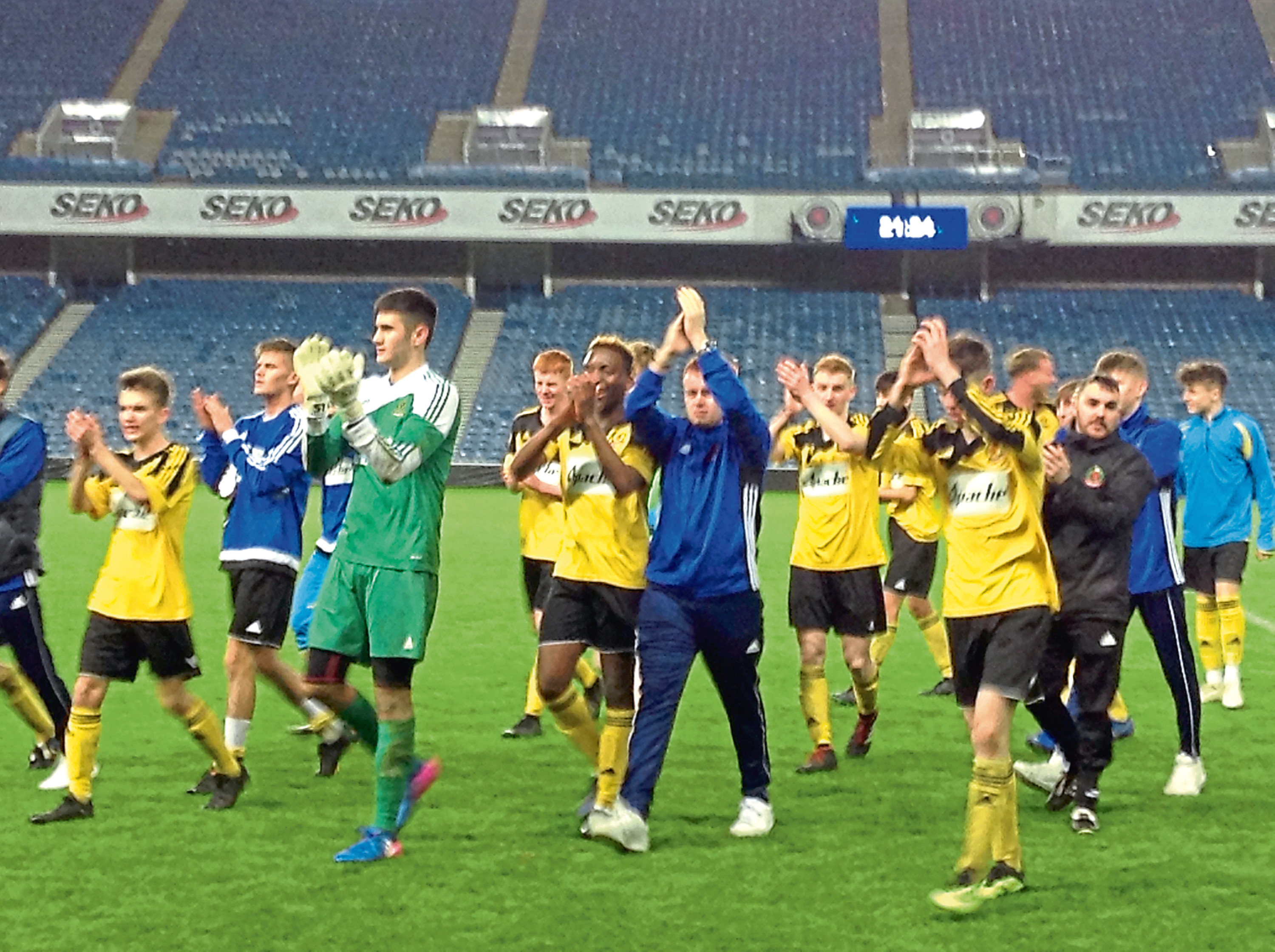 Cove Rangers youth side applaud their fans at Ibrox.