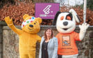 Leigh Ryrie, Charlie House's children and family support manager, celebrates the  six-figure cash donation from BBC's Children in Need fund