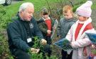 Countryside officer Ian Talboys talks to Westpark's P2 class