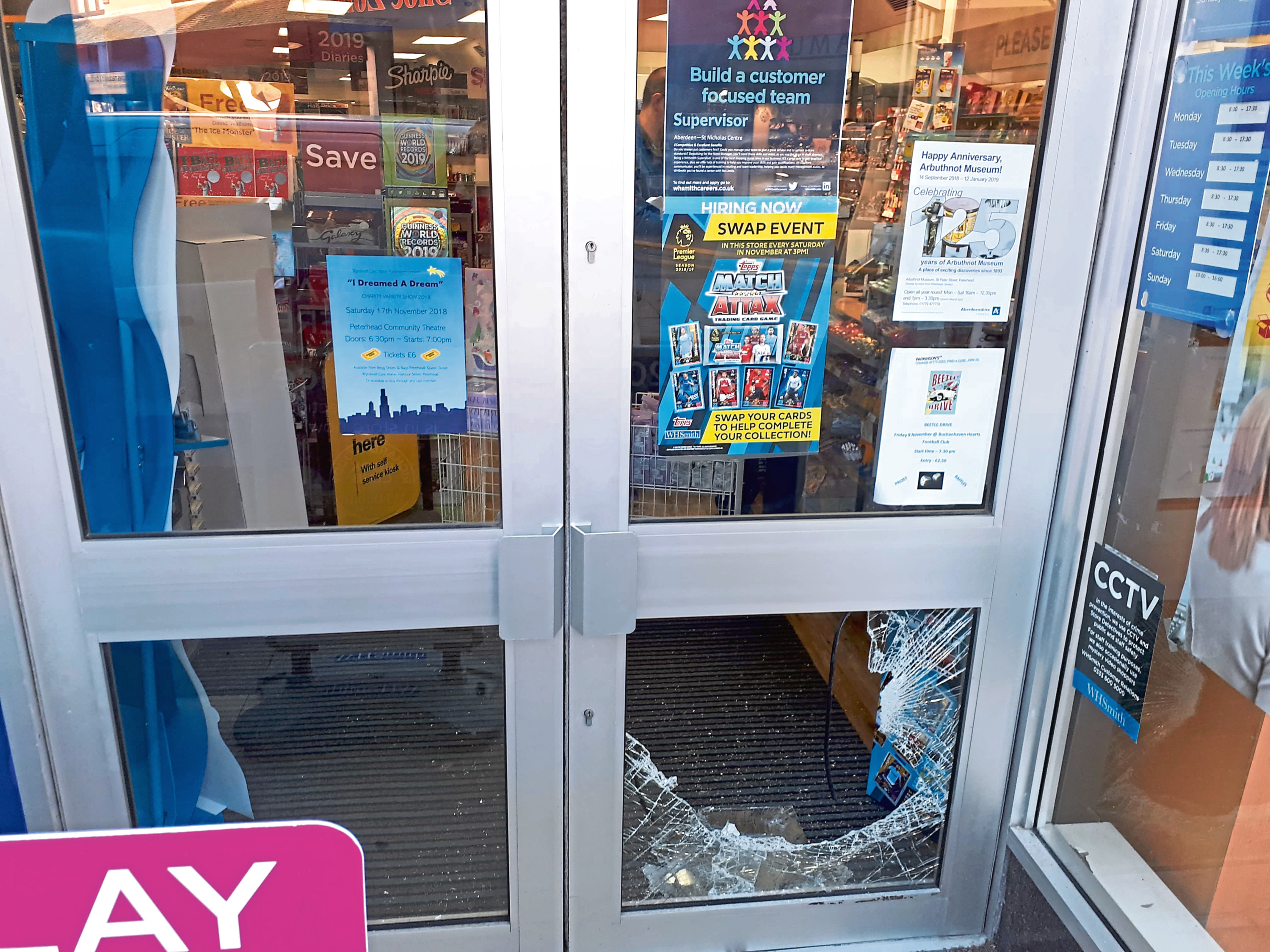 The door of the newsagents was smashed.