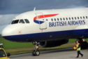 A British Airways aircraft arrives at Aberdeen airport
