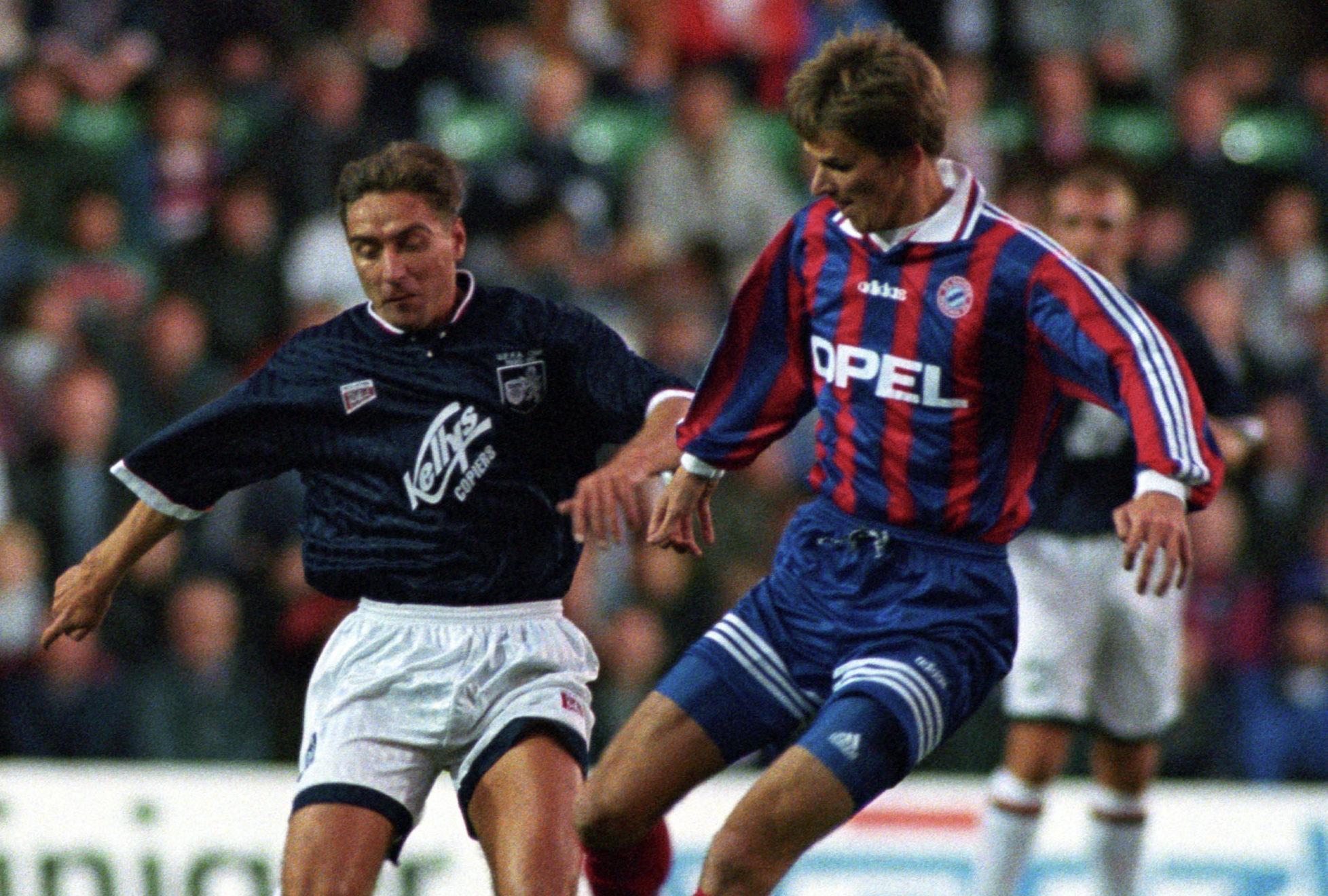 Raith's Jim McInally, left, battles for the ball with  Dietmar Hamann of Bayern Munich.
