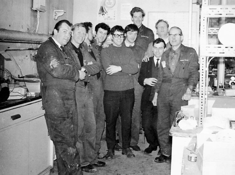 Reader George Taylor sent in this picture of himself, pictured centre with glasses, with workmates at Stoneywood paper mill, just before he left to emigrate to South Africa in 1969