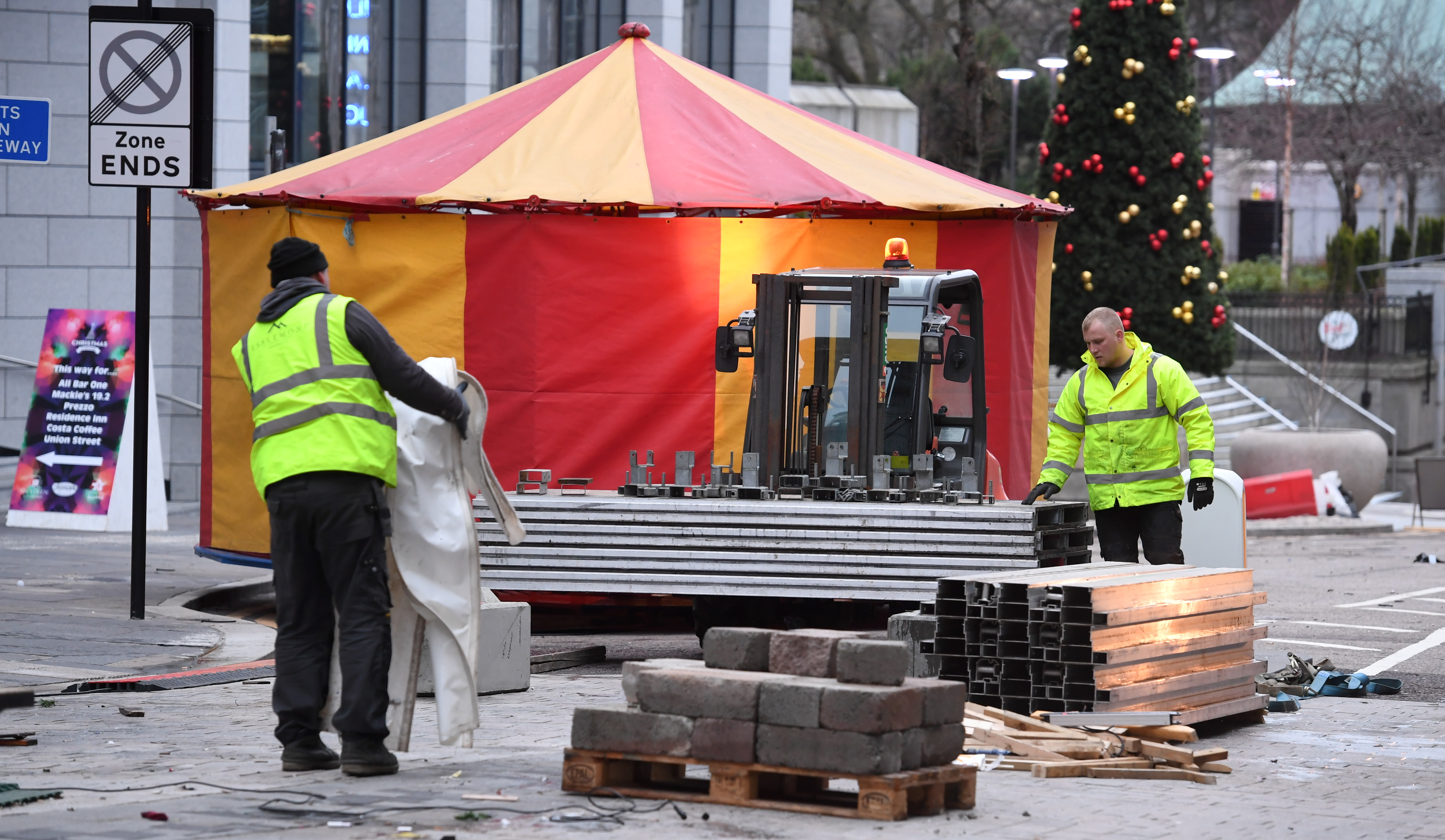 Crews are removing the stalls and rides from the Christmas village