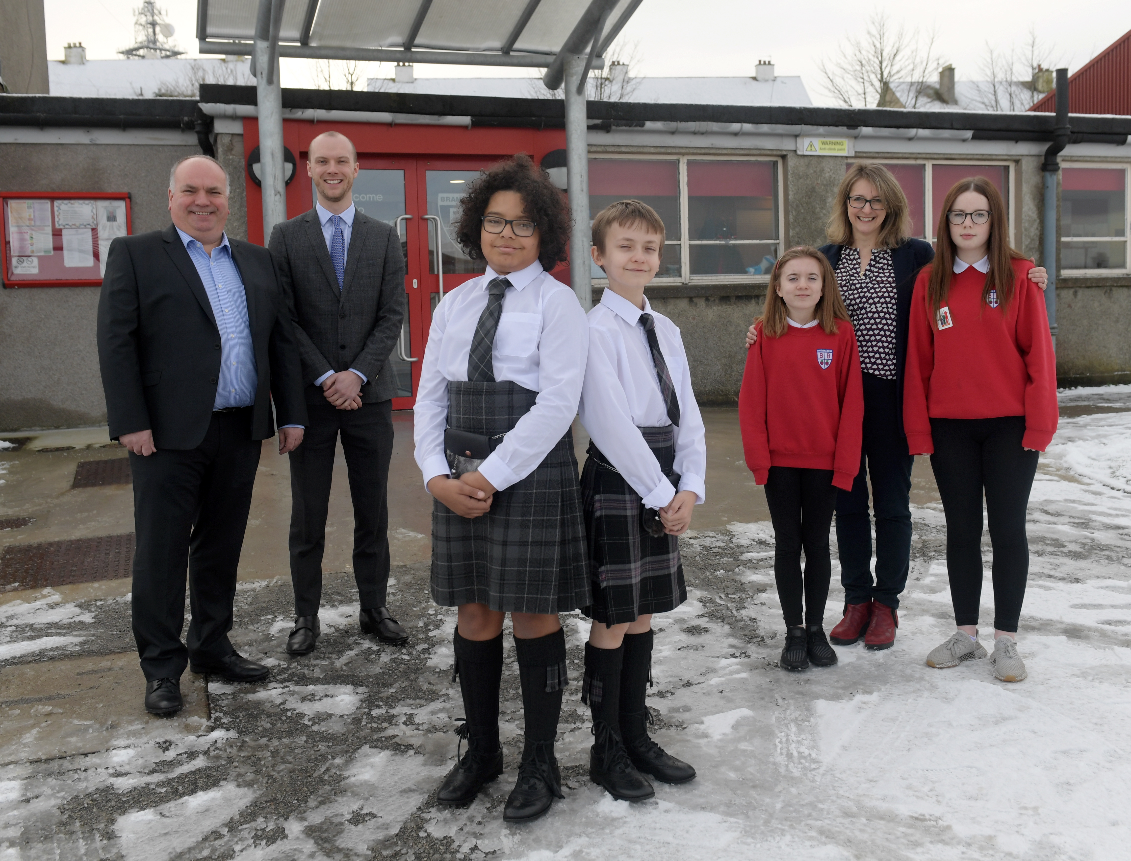 Milsom & Main's David Main, Ross Gardiner from Brodies, pupils Sammy Pedro, Arran Havelock, Katie Kerr and Jessica Wood with Buisiness and Community Ambassador Chris Dunhill