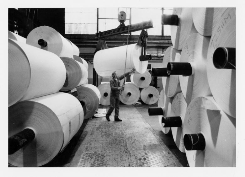 Mountains of huge paper rools stacked high at the Stoneywood paper mill 1988